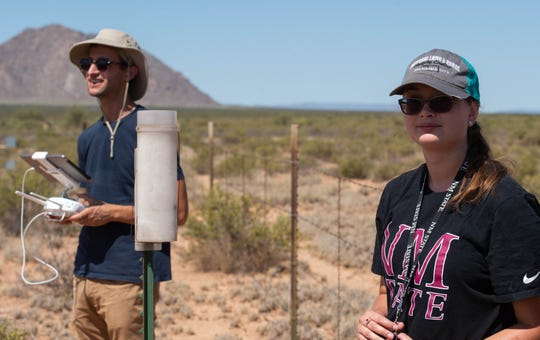 Robert Wojcikiewicz, left, and Emily Doss, right, fly a drone for a geographic surveying experiment, Friday, Aug. 30, 2019 at the Jornada Experimental Range.