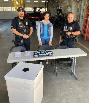 Unified Prevention Coalition's Alyssa Myrick (center) joined Sunland Park Officers Armando Duran (right) and Officer Lucas Alvarez (left) for Drug Take Back Day in October. Sunland Park residents safely disposed of almost 24 pounds of medications during the four-hour event.