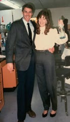 Nancy Reichert and John Kemp celebrate Reichert's graduation in December 1989. Reichert earned a Ph.D. in molecular biology from New Mexico State University, becoming the first student to graduate from NMSU's Molecular Biology Program.