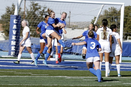 The Carlsbad Cavegirls celebrate Alexa Dugan's game-winning rebound goal against Hobbs in overtime on Nov. 2, 2019. Carlsbad won, 1-0.