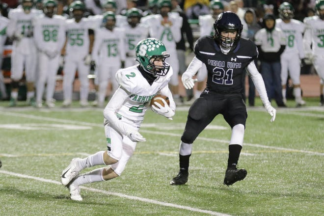 Farmington's Peyton Halliburton pushes forward for a first down against Piedra Vista's Tyler Wulfert during a District  1-5A football game on Friday,  Nov. 1, 2019, at Hutchison Stadium in Farmington.