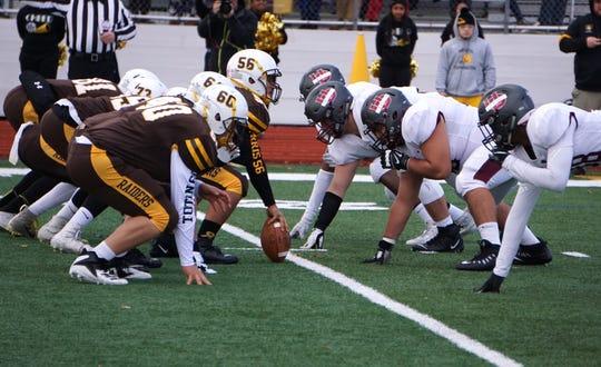 North Farmington lines up against the UofD defense on Nov. 2.
