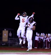 Wide receivers Brendan Lowry and Khalil Ford celebrate a touchdown. Livonia Churchill defeats Dexter, 41-39, in the predistrict round of the MHSAA high school football playoffs.