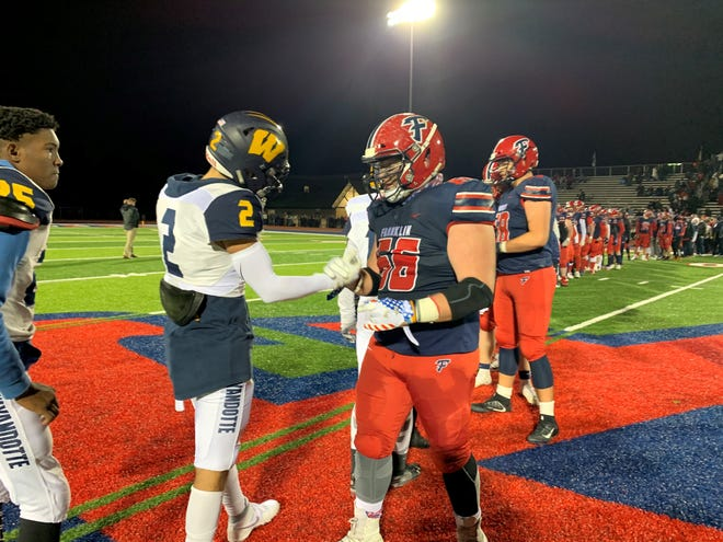 Livonia Franklin's Jake Swirple shakes hands with a Wyandotte Roosevelt player after Franklin won 23-7 to advance to the district final on Nov. 1, 2019.