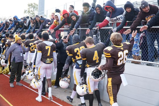 North Farmington Raider players thank their fans after Saturday's playoff game against UofD Jesuit.