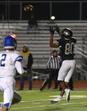 Plymouth's Ivan Davis hauls in this pass for the Wildcats' first touchdown.