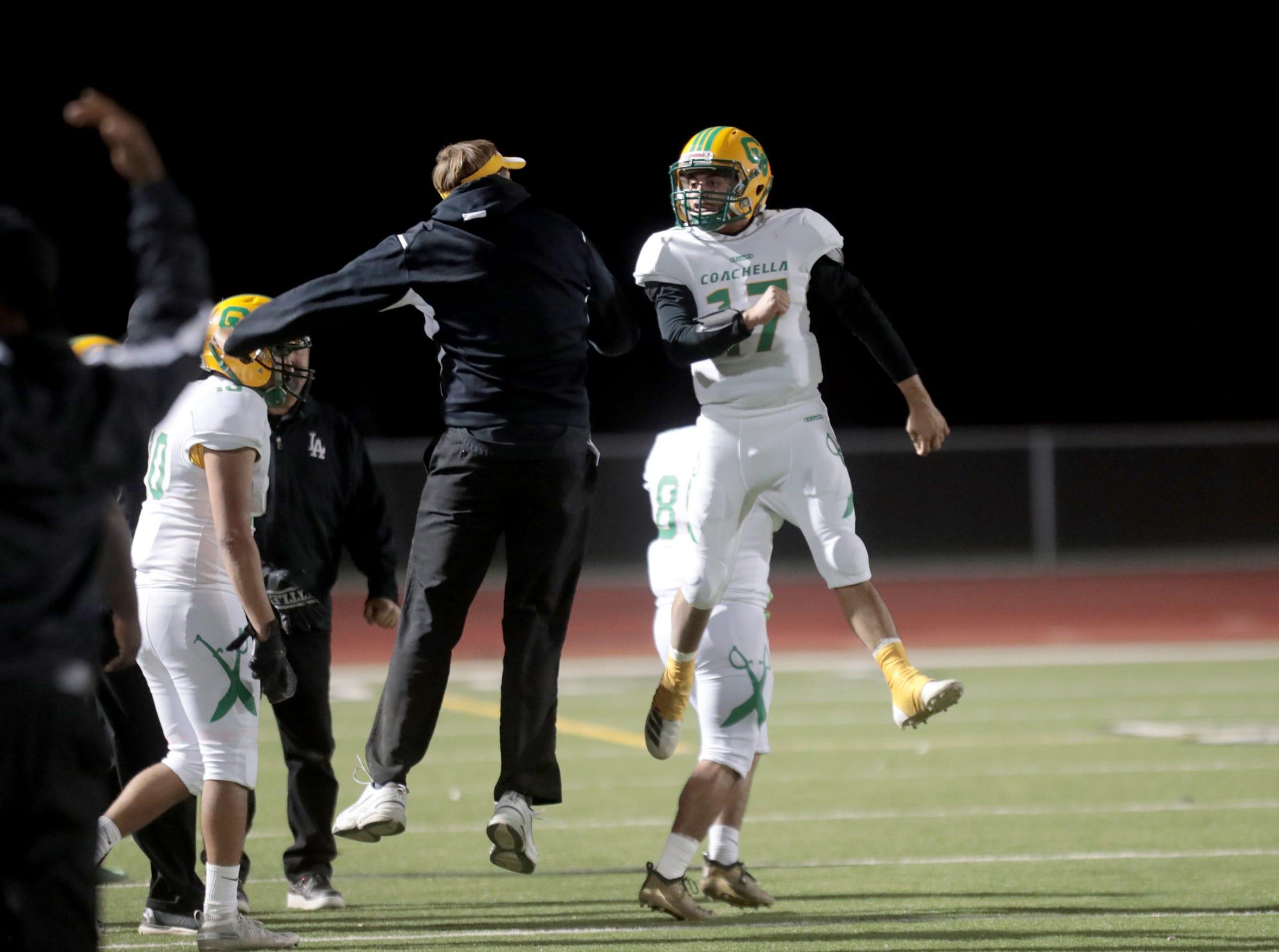 Coachella Valley's quarterback Jacob Calderon (right)