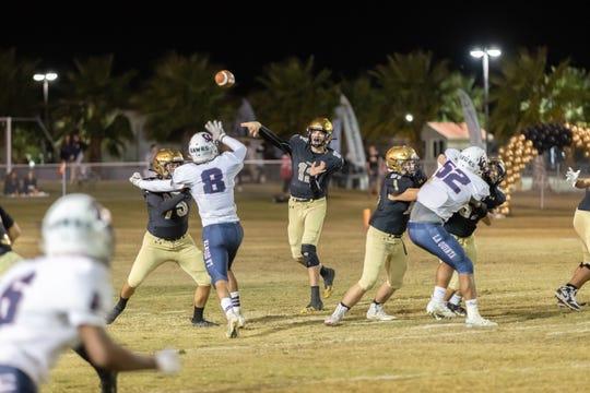 Xavier Prep quarterback Brad McClure throws a pass against La Quiknta in high school football Nov. 1, 2019.