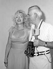 A suntanned Marilyn Monroe with photographer and friend Bruno Bernard in 1961.