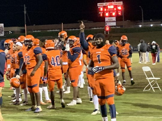 Frank Peasant (1) enjoys Escambia's final touchdown Friday night.