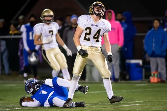Delone Catholic's Tate Neiderer reacts after tackling Steel-High quarterback Nyles Jones for a loss on a key third-down play to force a fourth-and-ten late in the fourth quarter of a District III Class 2A semifinal game in Steelton on Friday, Nov. 1, 2019. The Squires won, 39-27.