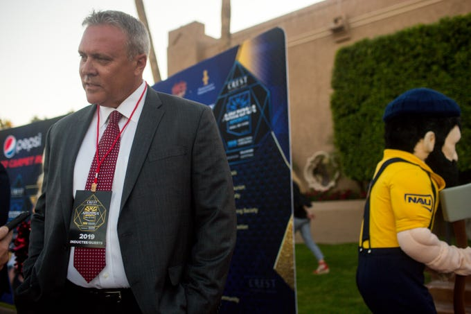 Rich Tomey speaks with reporters about his late father, Dick Tomey, winningest head coach in University of Arizona football history, at the 2019 induction ceremony into the Arizona Sports Hall of Fame Friday, November 1, 2019 at the Scottsdale Plaza Resort.