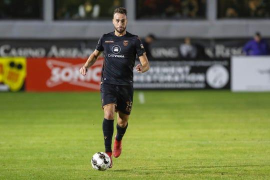 Phoenix Rising FC defender Joey Farrell (15) dribbles the ball against Real Monarchs SLC on Nov. 1, 2019 at Casino Arizona Field. (Brady Klain/The Republic)