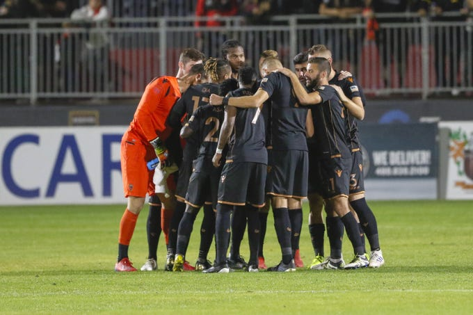 Phoenix Rising FC huddle together prior to their matchup against Real Monarchs SLC on Nov. 1, 2019 at Casino Arizona Field. (Brady Klain/The Republic)