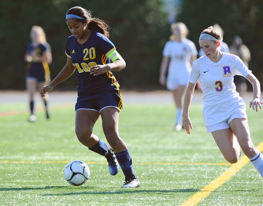 Elco's Tanisha Grewal (20) moves the ball past B-S's Bry McBeth (3) during first half action.