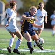 Elco's Emma Fox (39) goes hard for this ball against B-S's Bry McBeth (3) during first half action.
