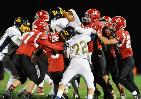 Littlestown RB Wyatt Kramer (34) is stopped by a herd of A-C Dutchmen on this play during the third quarter of action.