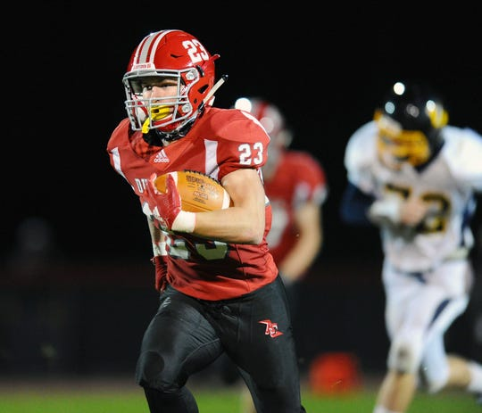 A-C's Evan Heilman (23) heads down the field on a 63 yard touchdown run during the second quarter of action.