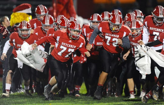 The Annville-Cleona Dutchmen storm the field prior to the start of their District 3 3A first round playoff game against the Littlestown Thunderbolts in Annville on Friday Nov.1,2019.
