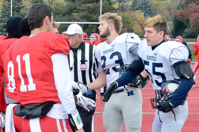 Marysville captains Parker Foster and Sam Lasher shake hands with players from Orchard Lake St. Mary's before the Division 3 football pre-district Saturday, Nov. 2, 2019, at Monsignor Milewski Stadium in Orchard Lake Village.