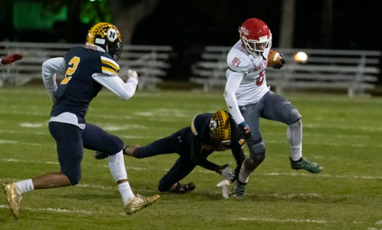 Port Huron's Dawson Leffler breaks a tackle during their football game against Port Huron Northern Friday Nov. 1 at Memorial Stadium in Port Huron.