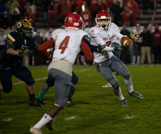 Port Huron's Dawson Leffler pitches the ball to teammate Nijere Finney on a reverse during their football game against Port Huron Northern on Friday, Nov. 1, at Memorial Stadium in Port Huron.