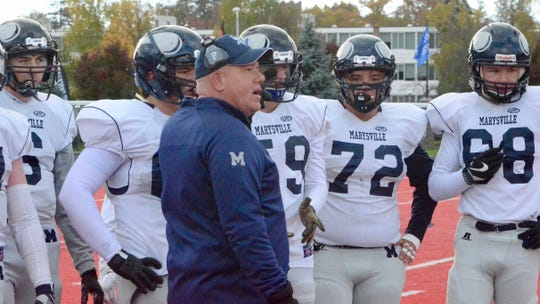 Marysville coach Derek Meier talks with the offensive line during a timeout against Orchard Lake St. Mary's in the Division 3 football pre-district Saturday, Nov. 2, 2019, at Monsignor Milewski Stadium in Orchard Lake Village.