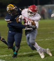 Port Huron's Luke Van Der Feyst is tackled by Port Huron Northern's John Young during their football game Friday Nov. 1 at Memorial Stadium in Port Huron.