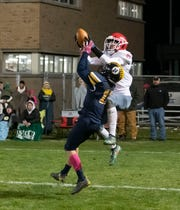 Port Huron's Dawson Leffler catches the game-winning touchdown pass as Port Huron Northern's James DeLong covers him during their football game Friday Nov. 1 at Memorial Stadium in Port Huron.