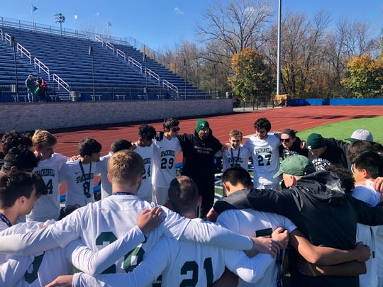 The Spackenkill boys soccer team huddles with coach Manny Blanco after falling to Burke Catholic in the Section 9 Class B final on Saturday.