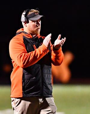 Northeastern head coach Jon Scepanski