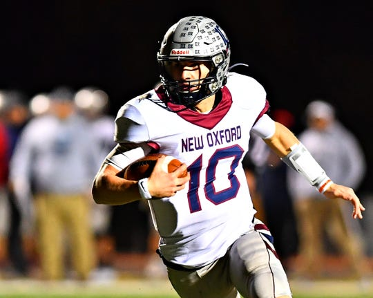 New Oxford's Brayden Long runs the ball to gain some yardage during PIAA District 3, Class 5-A quarterfinal football action against Northeastern at Northeastern Senior High School in Manchester, Friday, Nov. 1, 2019. New Oxford would win the game 41-14. Dawn J. Sagert photo