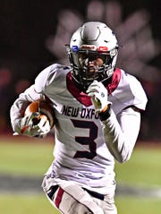 New Oxford's Abdul Janneh carries the ball during PIAA District 3, Class 5-A quarterfinal football action against Northeastern at Northeastern Senior High School in Manchester, Friday, Nov. 1, 2019. New Oxford would win the game 41-14. Dawn J. Sagert photo