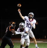 Brayden Long (10) throws during the district 3 5A game between Northeastern and New Oxford at Northeastern High School, November 1, 2019. The Colonials defeated the Bobcats 41-14.