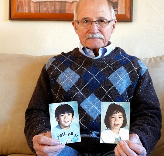 Ron Dreher, a retired detective with the Reno Police Department, holds two photos of 8-year-old Charles Chia and his 6-year-old sister, Jennifer. The children were abducted while walking home from the school bus stop on Oct. 18, 1989. Their remains were discovered nine months later at a turnout near Blairsden, Calif. Dreher was the lead detective investigating the case in 1989.