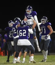 Spanish Springs' Trey Hummel celebrates with his teammates after scoring while taking on Reed during their football game on Nov. 1, 2019.