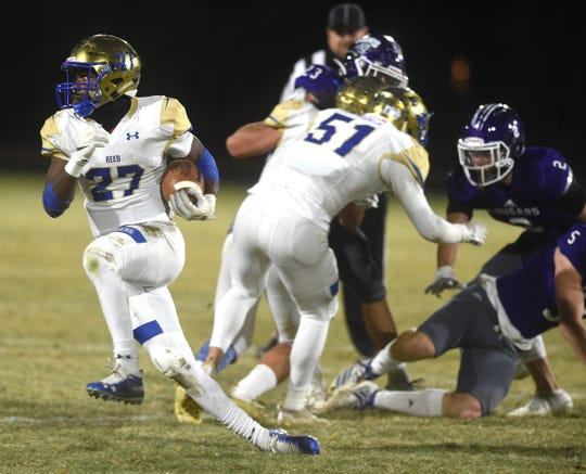 Reed's Elijah Tau-Tolliver runs free against Spanish Springs during their football game on Nov. 1, 2019.