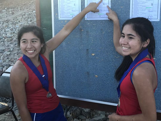 In girls doubles, Reno High sisters Jazlynn (left) and Celeste Parker won the title.