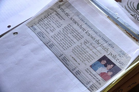 A close up photo of a newspaper clipping taken from the Reno Gazette Journal. The article, published in 2005, tells the story of the kidnappings and murders of both Charles Chia, 8, and his sister, Jennifer Chia, 6, both of Reno. The siblings were abducted on Oct. 18, 1989, and their remains were found nine months later at a turnout near Blairsden, Calif.