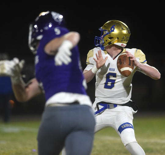 Reed's Jack Franz looks to throw against Spanish Springs during their football game on Nov. 1, 2019.
