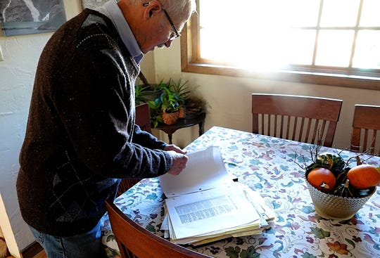 Ron Dreher, a retired homicide detective with the Reno Police Department, looks through a binder filled with newspaper clippings and notes. The binder contains information on the kidnappings and murders of both Charles Chia, 8, and his 6-year-old sister, Jennifer. Dreher was the lead investigator on the case back in 1989.