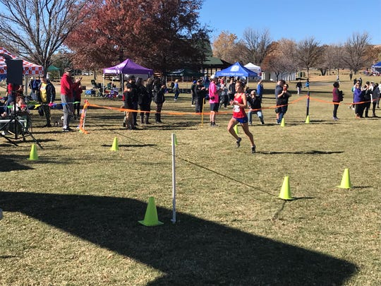 Reno junior Penelope Smerdon won the girls Northern 4A Regional cross country race Saturday.