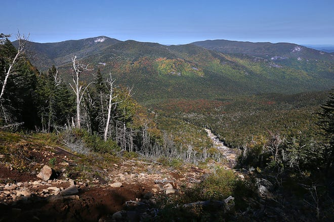 Looking out over the High Peaks region from the top of Bennies Brook Slide on Lower Wolf Jaw in the High Peaks of the Adirondacks