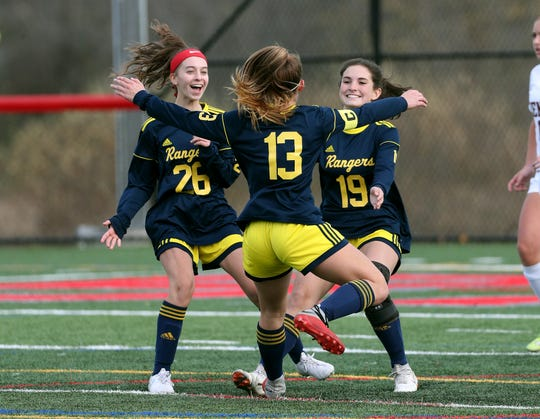 Spencerport's Sabrina Trapani (13) celebrates her first half  goal with teammates Kathleen Fitzgerald  (26) and Breanna DeHond (19) in route to a 2-0 win over Pittsford Mendon and the Class A championship.