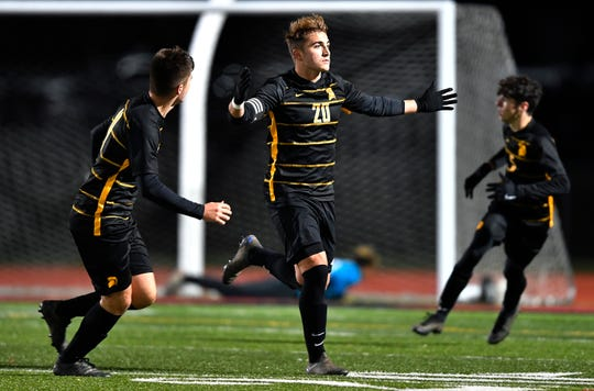 Greece Athena's Dylan Rice, center, celebrates his first goal of the night against Greece Arcadia during the Class A1 sectional final at Hilton High School, Friday, Nov. 1, 2019. Rice scored twice in Athena's 3-2 victory.