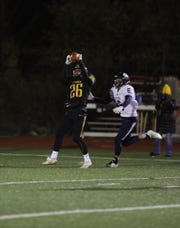 McQuaid senior Casey Howlett, catching a pass this season, was one of the recipients of a scholarship from the Rochester-chapter of the National Football Foundation and College Football Hall of Fame.
