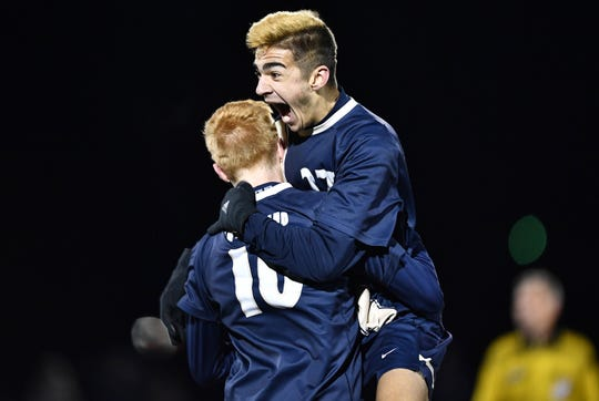 Pittsford Sutherland's Will Bowen, right, celebrates with Drew Kull after beating Wayne in the Class A2 sectional final at Hilton High School, Friday, Nov. 1, 2019. No. 1 seed Pittsford Sutherland claimed the A2 title with a 1-0 win over No.2 seed Wayne.