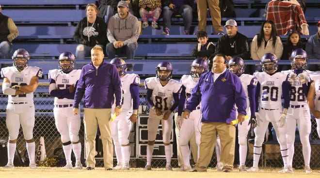 Ozona High School head football coach Kyle Freeman (third from left) and the Lions remained undefeated in District 3-2A Division I with a 25-6 win against Winters at Blizzards Stadium on Friday, Nov. 1, 2019.