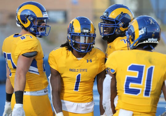 Angelo State University's Alize Thomas is congratulated by teammates after scoring a touchdown earlier in the 2019 season.