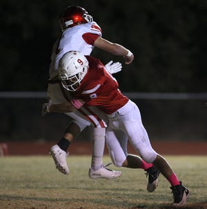 Luke Jolly, right, makes a tackle for Christoval on Friday, Nov. 1, 2019.